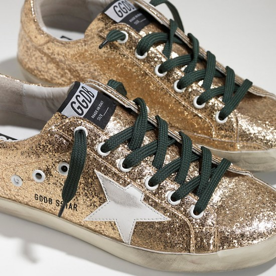 Women's Golden Goose sneakers superstar in gold glitter emerald