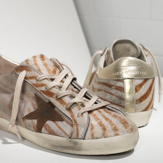 Women's Golden Goose sneakers superstar in gold zebra