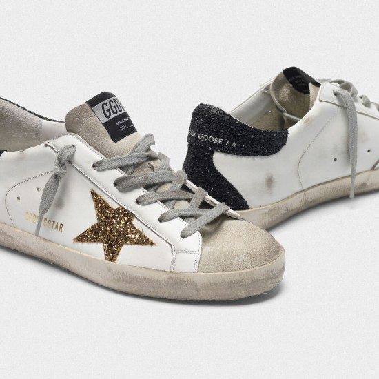 Women's Golden Goose superstar sneakers with gold star and glittery black
