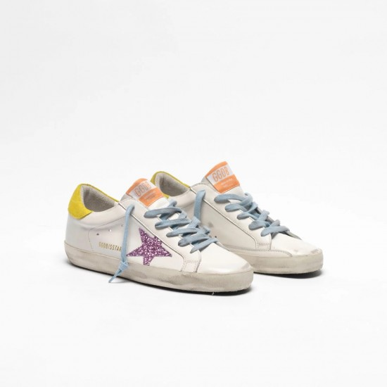 Women's Golden Goose superstar sneakers with pink glittery star and yellow